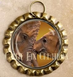 Bottle Cap Bronze Pendant with Original Artwork. Elephant love. Mother and baby elephant. Great for purse charms, day planner charms, keychain charms and zipper pulls.