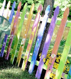 not your boring picket fence, add some vines to it and it's a lovely cottage garden style fence.