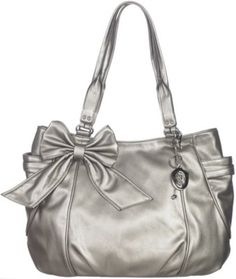b28078d67f67 Genna De Rossi delivers style and storage with this tote handbag featuring  a main lined compartment