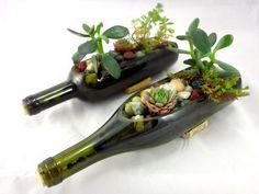 21 diy wine bottle mini garden http://hative.com/creative-wine-bottle-centerpieces/
