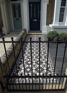 Metal gate rails path Victorian mosaic London slate paving planting Imperial brick London Fulham Chelsea Kensington