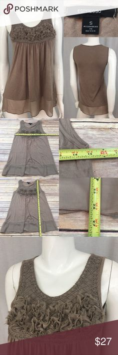 💞 Small Expresso Taupe Sleeveless Sheer Trim Top Measurements are in photos. Normal wash wear, has a stain on the back, no other flaws. D1/38  I do not comment to my buyers after purchases, due to their privacy. If you would like any reassurance after your purchase that I did receive your order, please feel free to comment on the listing and I will promptly respond.   I ship everyday and I always package safely. Thank you for shopping my closet! Expresso Tops