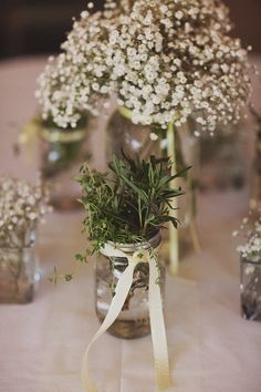 Herbs mixed with baby's breath flowers (great idea for a warmer months table centerpiece)