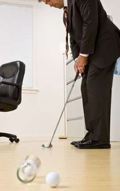 Five ways to play golf in the office. Don't we all wish we could get away with playing golf in the office?