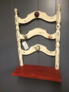 Cute little jewelry holder with shelf made from old chair back, wood and knobs.