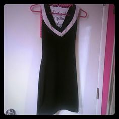 Black and white mini dress Cute simple black dress with crisscross back.  Never wore Dresses Mini