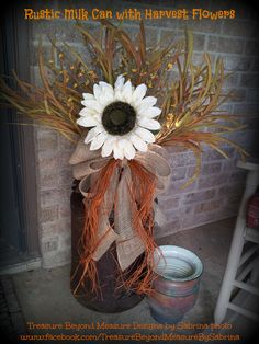Rustic and rusty, old milk can with Fall flowers. https://www.facebook.com/TreasureBeyondMeasureBySabrina