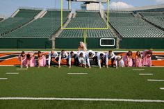 Love this photo of the wedding party on a football field! Photo by: Cincinnati Digital Photography