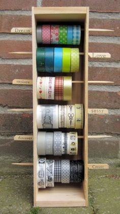Washi tape storage in an altered wine box.  Beautiful work by Hermine.  Check out her blog to see how she decorated the box.