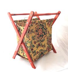 Vintage folding tapestry knitting crochet basket sewing storage bag with wooden stand wooden handles yarn wool holder retro magazine rack Lightweight tapestry storage bag on wooden frame. This pretty storage bag is made of a floral tapestry material. It would be great for storing yarn and your unfinished knitting and crochet items. Alternatively it could be used as a magazine rack. In lovely condition this item measures 17 inches in height, 13 inches in width and 10 inches in depth, from…