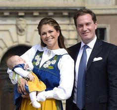 Happy family: Christopher O'Neill (R) stands with wife Princess Madeleine of Sweden (L) who holds their three-month-old daughter Princess Le...
