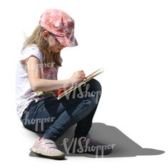 A girl with a pink hat sitting and drawing
