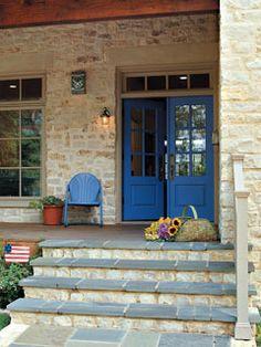 Love the stone, porch & doors