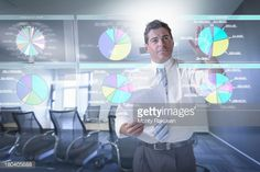 Stock Photo : Businessman looking at pie charts on interactive screen
