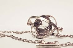 The Harry Potter Nerd in me wants this so badly! hermoine's time turner