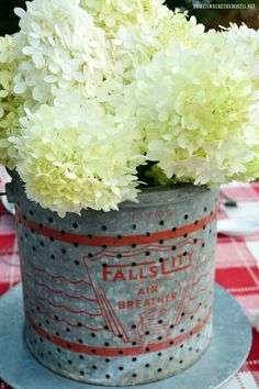 Vintage minnow bucket centerpiece with hydrangeas for a summer lakeside fishing theme table! | homeiswheretheboatis.net