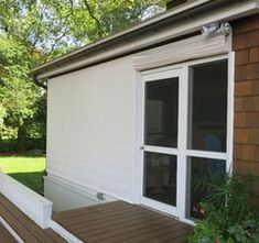 Screen porch shades keep dirt and rain out of porch.