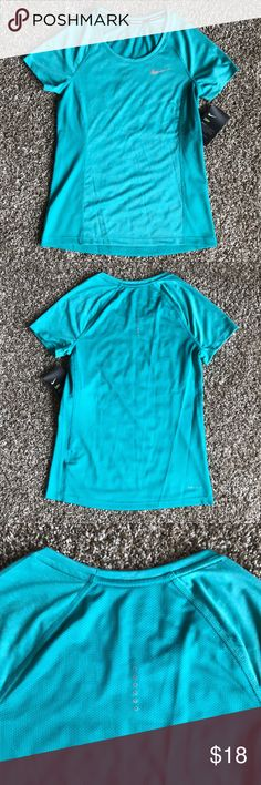 XS Nike Dri-Fit Running T-Shirt *Brand New* XS Nike Dri-Fit Running T-Shirt. Turquoise in color  ** My pictures show that this top is light blue—- but it is actually more turquoise in color!** Nike Tops