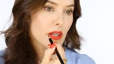 Ultimate Guide To Red Lips - Make-up Tutorial. This video is awesome! She shares a bunch of her favorite red lipsticks for all skin tones (even hair color). She offers a good range of sheer, matte, shimmery, and glossy. And then she talks about (and shows you) how to apply a red lip. I like her videos because she really focuses on you doing what you like/what you're comfortable with doing!