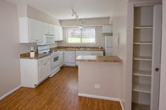 Three bedroom kitchen featuring breakfast bar, granite style countertops, and all whirlpool appliances.