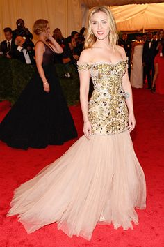 Scarlett Johansson at the Met Costume Gala- The actress went all out in a strapless Dolce & Gabbana gown with a tulle mermaid skirt and gold embroidered bodice and Fred Leighton earrings.