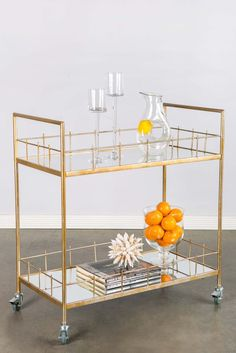 """It will be shipped last week of January. Bar cart with mirrored glass and wheels Materials : Metal, glass Measurements: 32.5""""h x 34"""" w x 17""""d, 34 pounds"""