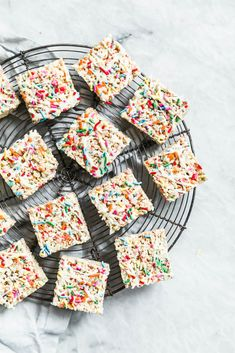 The easiest, prettiest White Chocolate Funfetti Rice Krispie Treats ever! Made with only 5 ingredients, these babies come together in just minutes! // @BromaBakery