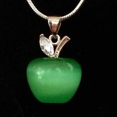 """Green Apple Opalescent Necklace ☑️Bundle & Save☑️  Cats Eye Opalescent Apple Pendant w/ Necklace.  Absolutely beautiful!   Pendant Size: 2mm long Main Stone: Opalescent  Metal: 925 Silver Color: Green Necklace: 18"""" Snake Rope Necklace  Necklace Material: 925 Sterling Silver Package Includes: Pendant and Chain None Jewelry Necklaces"""