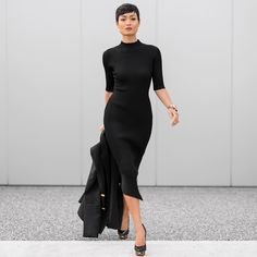@micahgianneli works it in a jet-black knit dress, accented black pumps and gold accessories #StreetStyle #AllBlack