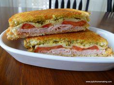 http://joyfulhomemaking.com/2013/03/pesto-tomato-mozzarella-grilled-cheese-sandwich.html