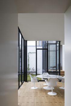 An airy breakfast room in a stunning historical home reno by Hans Verstuyft Architecten.