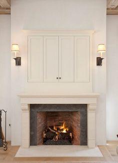 Hidden TV over fireplace, living room, RT Abbott Construction Hide Tv Over Fireplace, Fireplace Doors, Home Fireplace, Living Room With Fireplace, Fireplace Design, Fireplace Ideas, Fireplace Decorations, Limestone Fireplace, Fireplaces With Tv Above