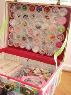 I have a old train case I use for jewery making supply storage - I need to trick it out like this. Those circle containers are attached to the lid with magnets!