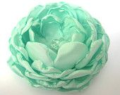 Small mint green fabric flower, flower for sash, bridal hair clip, bridesmaid's accessories. $20.00, via Etsy.