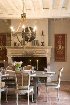 mantel, table, rafters, chandelier, brick floors....