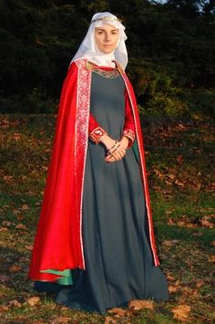 Costume is inspired by Codex Mannese (1300-1320). Cloak is made of orange silk green wool underlaid. Clothing is fastened by two brass fibulas connected by silk tie. Also, at some point I want a cloak in this style.