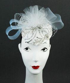 White satin with tulle headpiece