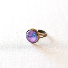 Juju Treasures Purple Galaxy Ring ($19) ❤ liked on Polyvore featuring jewelry, rings, purple ring, purple jewellery, purple jewelry, cosmic jewelry and galaxy ring