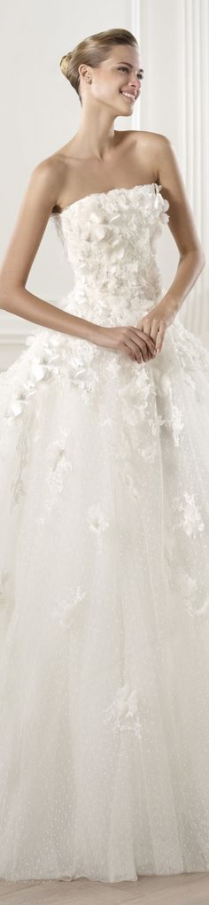 Petit pois and tulle wedding dress with crystal gemstone embroidery appliqués and organza flowers. Off-the-shoulder lace bodice with appliqués. The waist is emphasised by a fine Mikado silk belt. Princess skirt with cascading appliqués.  http://www.pronovias.com/wedding-dresses-elie-by-elie-saab-collection-2014-mensa