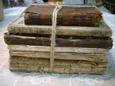 A Bundle of Tattered & Worn Books Tied Together With Twine