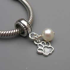 Pandora Charm with a paw print and a pearl.  Subtly representing the KY Wildcats :)