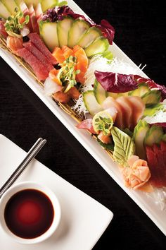 The collection of sashimi (salmon, tuna, white yellowtail, sea bass) in Tani Sushi Bistro's Sashimi Platter will surprise and satisfy any fan of raw fish. Photo credit: KEVIN ROBERTS. BEST DISHES, FEBRUARY 2012 ISSUE, PAGE 69.