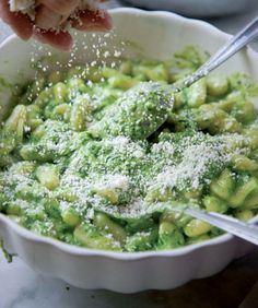 Tender gnocchi tossed with a classic pesto genovese is a popular first course in Liguria.