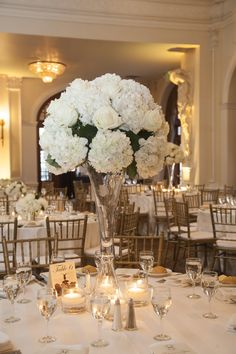 Formal Tall White Centerpieces -- Hydrangea + Giant Roses from Floral Events  || Beautiful wedding reception at the Crystal Ballroom at the Rice || Full wedding feature on SMP: http://www.StyleMePretty.com/southwest-weddings/2014/03/07/winter-wedding-at-the-crystal-ballroom/ Nhan Photography