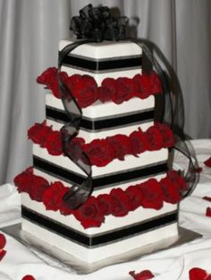 Red & black wedding cake. I would do purple and black.