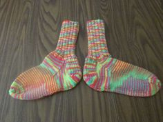 Here is a wonderful pair of hand knit adult size winter socks. The color is called Day Glow. Heel to toe is approx. 9 1/2 in. and the ribbing on the top (top to ankle) is approx. 6 1/2 in. These socks are made of 100% acrylic yarn and can be machine washed and dried.