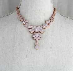 Rose Gold finish studded in tiny pave Swarovski Pure Brilliance cz stones to give it a look of real diamonds. A gorgeous modern leaf design with vintage inspired lines. You will not want to ever part with this necklace ! Available in 2 finishes. Necklace pictured measures 16.5 inches