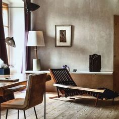 """scandinaviancollectors: """" Interior at the Château Limberg, Austria, studio-home of artist Erwin Wurn: The Long Chair in walnut by George Nakashima (1952) and a three-armed wall light by Serge Mouille (c.1950s). / Imgrum """""""