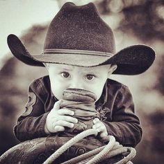 Handsome little cowboy on a roping saddle