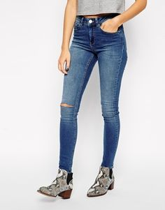 ASOS Mid Rise Skinny Jeans in Busted Mid Wash Blue with Ripped Knee